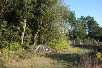 LA TURBALLE PROCHE PLAGE - Beau terrain constructible bien exposé à vendre - Quartier calme